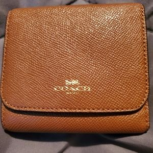 A classic leather coach wallet